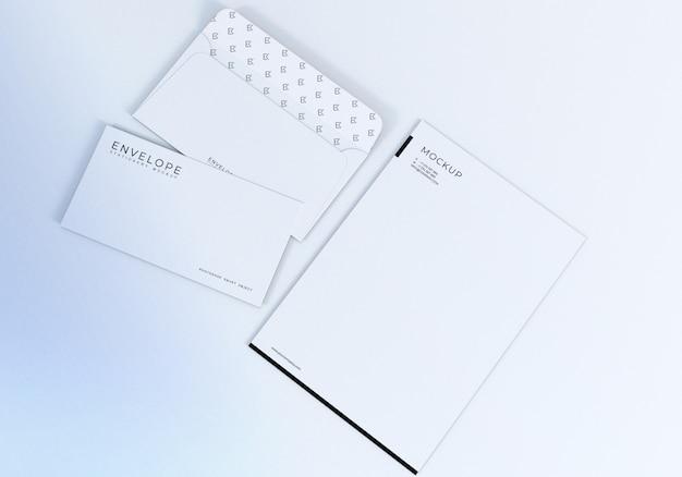 Maquete de design de envelope e papel timbrado branco