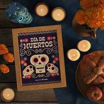 Maquete de dia de muertos, cercado por velas