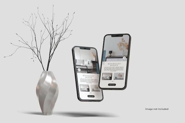 Maquete de dois smartphones com vaso de decoração
