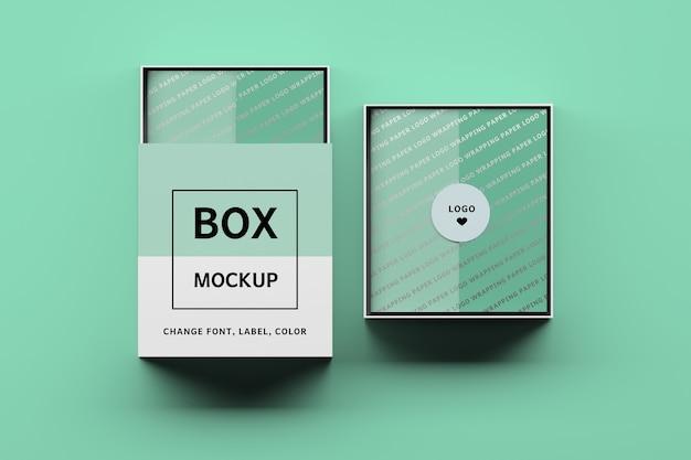Maquete de duas caixas com etiquetas editáveis e papel de embrulho