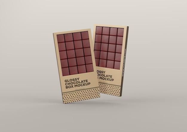 Maquete de duas caixas de chocolate brilhante