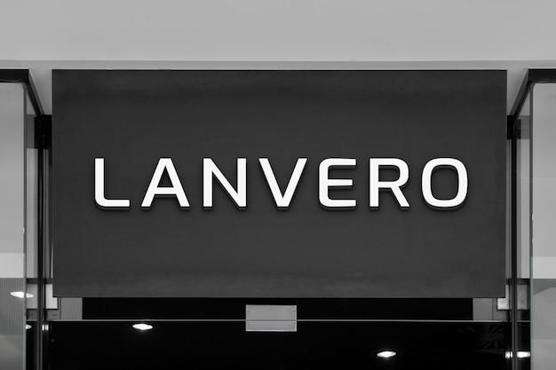 Maquete de elegante interior branco 3d logo sign na montra no centro comercial ou shopping