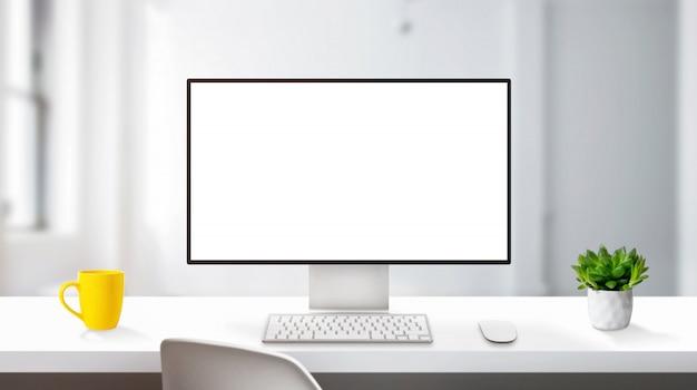 Maquete de exibição de computador moderno na mesa de trabalho com bordas finas. conceito de estúdio de design profissional