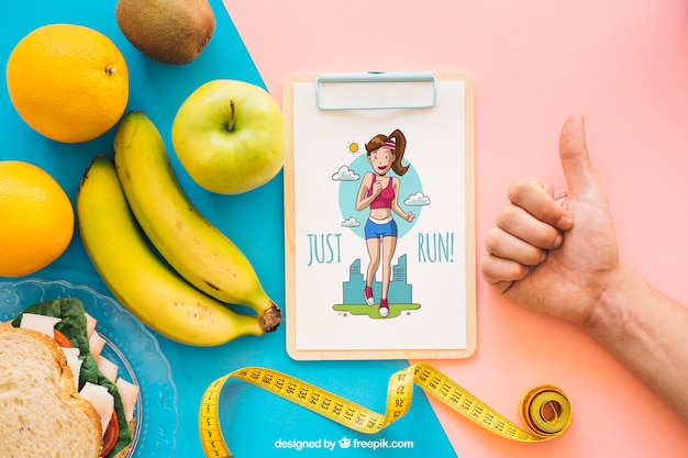 Maquete de fitness com clipboard e gesto de mão