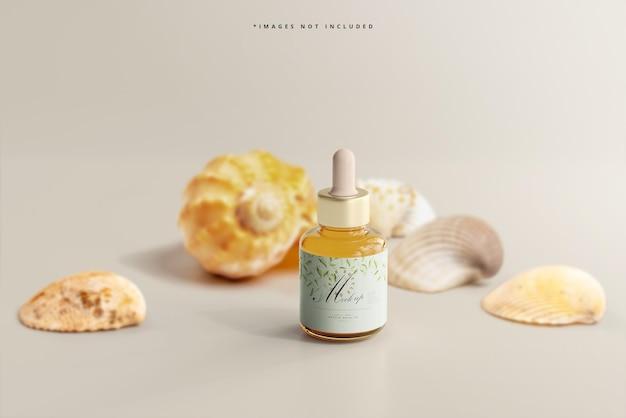 Maquete de frasco conta-gotas de vidro âmbar com conchas
