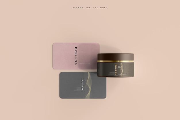 Maquete de frasco cosmético e cartões de visita