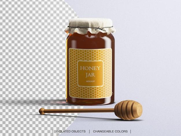Maquete de frasco de mel embalagem garrafa de vidro com colher de mel isolada