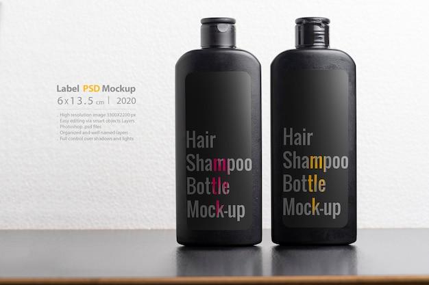Maquete de frascos de shampoo de cabelo preto