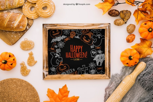 Maquete de halloween com ardósia e pão