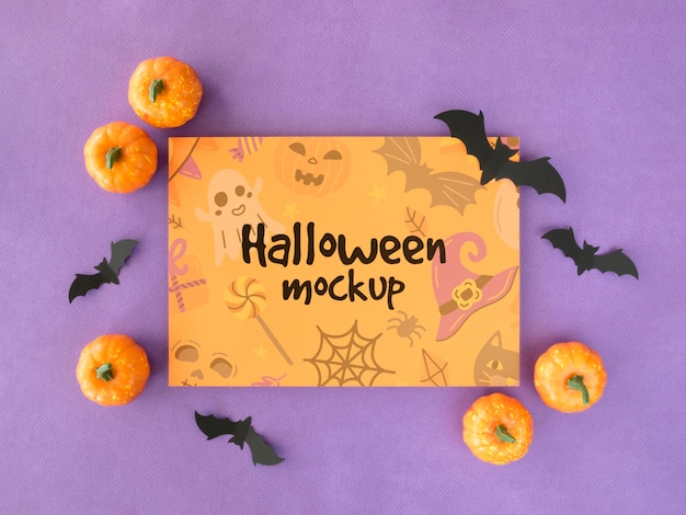 Maquete de halloween com morcegos e abóboras