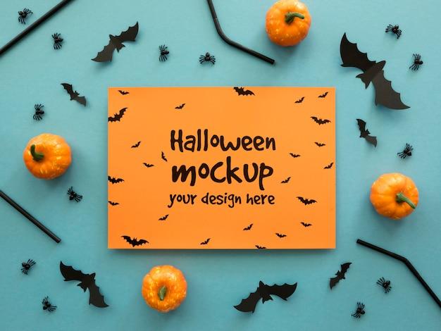 Maquete de halloween com pequenas abóboras