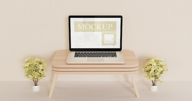 Maquete de laptop de tela na mesa de madeira da parede com plantas marrons decorativas
