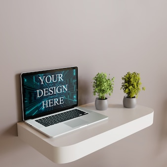 Maquete de laptop de tela na mesa de parede branca com plantas