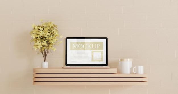 Maquete de laptop de tela na mini mesa de madeira com duas plantas decorativas