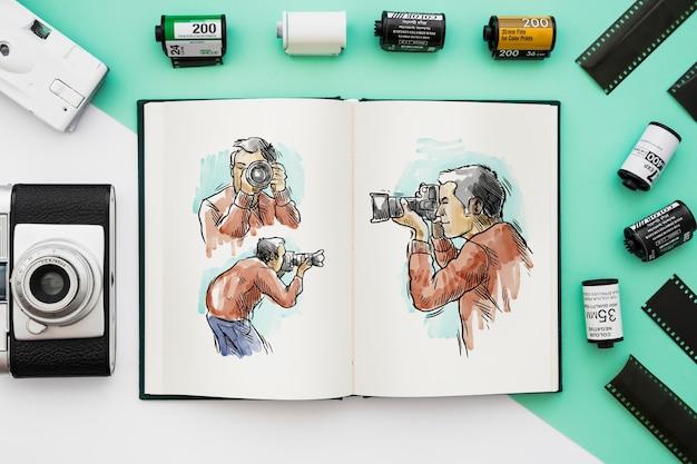 Maquete de livro aberto com o conceito de fotografia