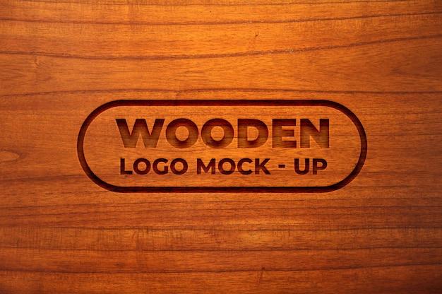 Maquete de logotipo com efeito de madeira gravada