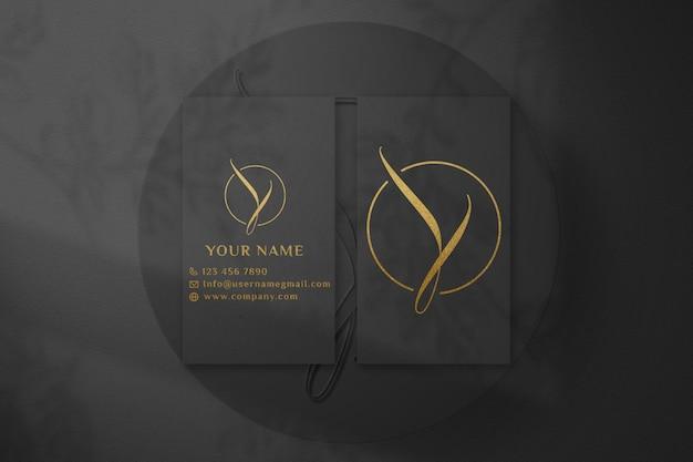 Maquete de logotipo de cartão de visita escuro de luxo