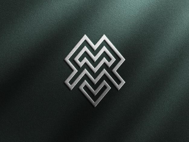Maquete de logotipo de luxo com efeito de relevo prateado