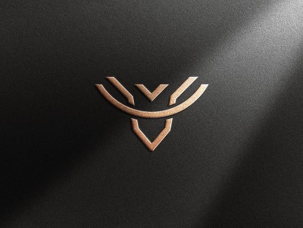 Maquete de logotipo de luxo com efeito dourado em relevo