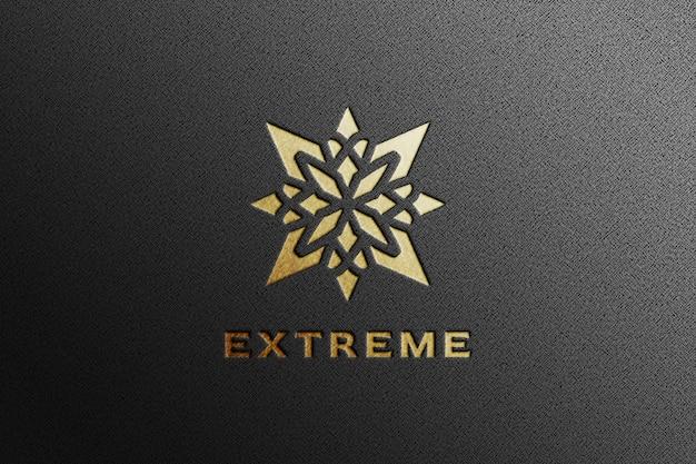 Maquete de logotipo de luxo com relevo dourado