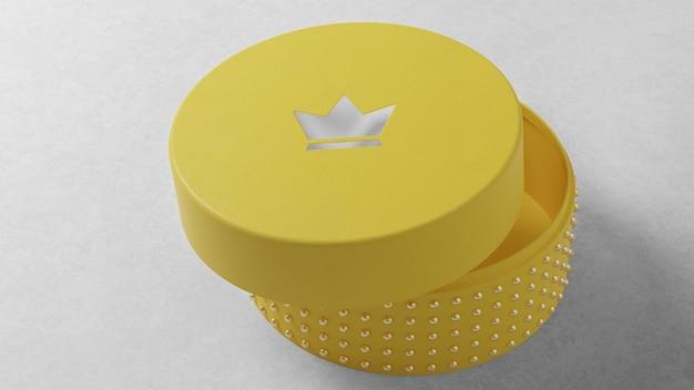 Maquete de logotipo de luxo em caixa de relógio de joias amarela redonda