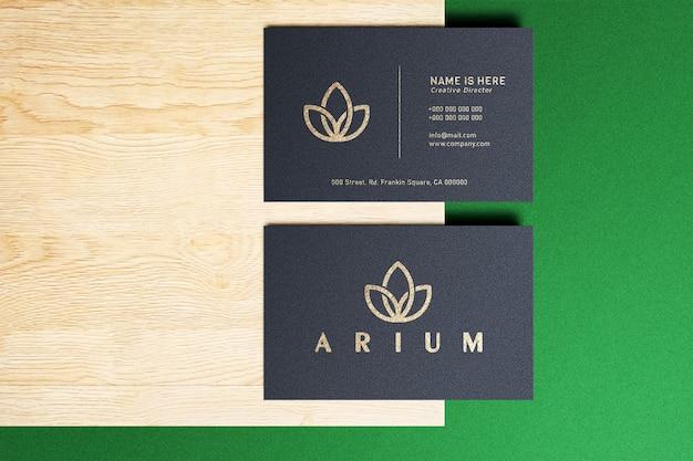 Maquete de logotipo de luxo em cartão preto