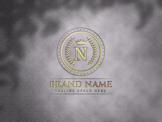 Maquete de logotipo de luxo em fundo de textura Psd Premium