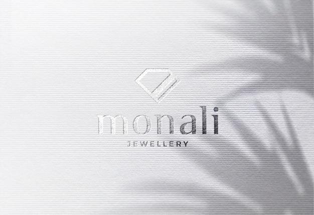Maquete de logotipo de luxo em papel listrado branco