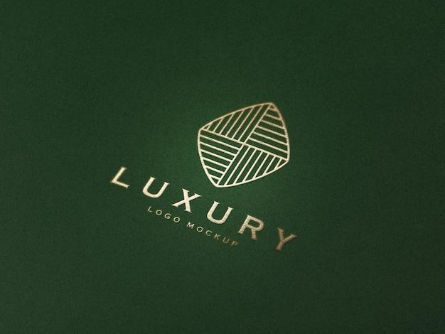 Maquete de logotipo de luxo em relevo ouro realista