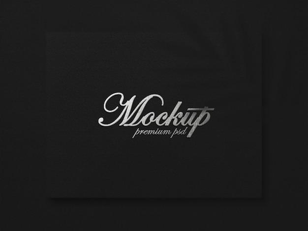 Maquete de logotipo de luxo em textura preta