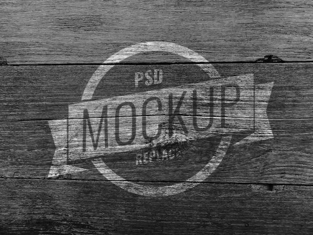 Maquete de logotipo de parede de madeira preta