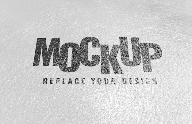 Maquete de logotipo de textura de tela de impressão de couro branco