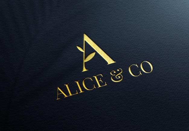 Maquete de logotipo dourado elegante em papel azul