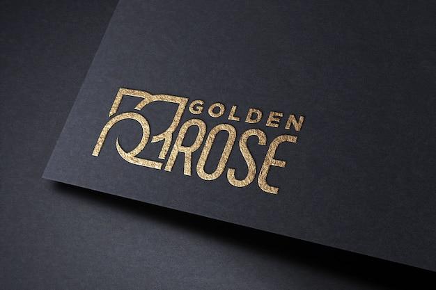 Maquete de logotipo dourado no papel