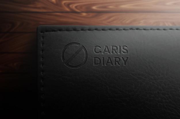Maquete de logotipo elegante caderno preto