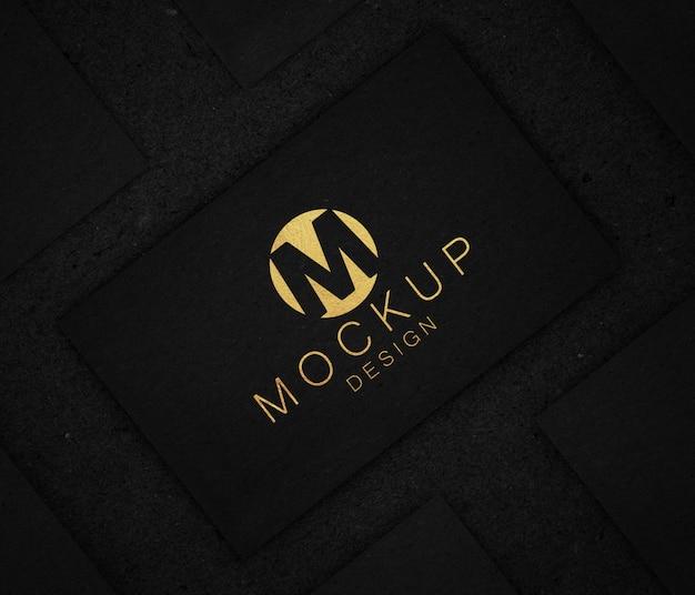 Maquete de logotipo elegante preto e dourado