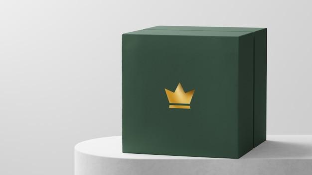 Maquete de logotipo luxuoso com caixa de relógio verde