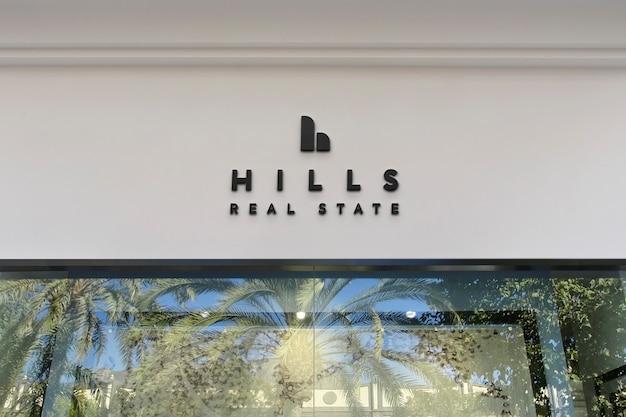 Maquete de logotipo moderno branco fachada preta sinal
