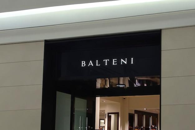 Maquete de logotipo moderno preto luminoso de fachada
