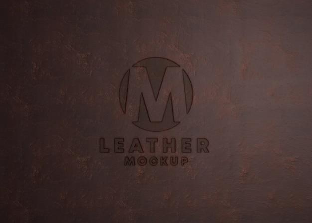 Maquete de logotipo na textura de couro