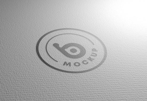 Maquete de logotipo na textura de papel branco