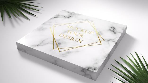 Maquete de logotipo ouro em mármore com folhas verdes