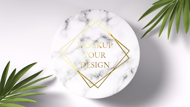 Maquete de logotipo ouro no círculo de mármore com folhas de palmeira