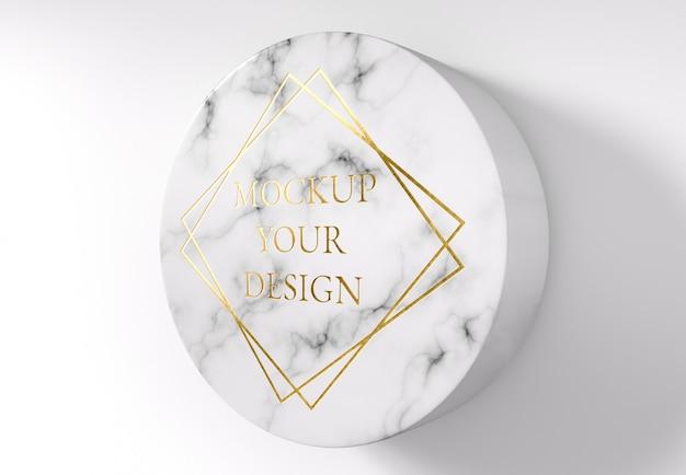 Maquete de logotipo ouro no mármore do círculo
