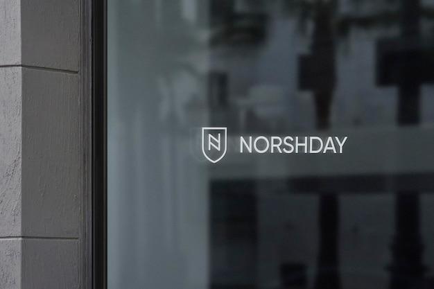 Maquete de logotipo para janela de escritório parede cinza