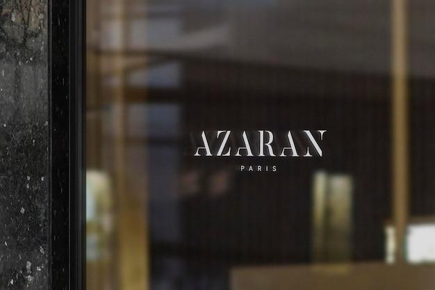 Maquete de logotipo para janela de luxo parede de mármore