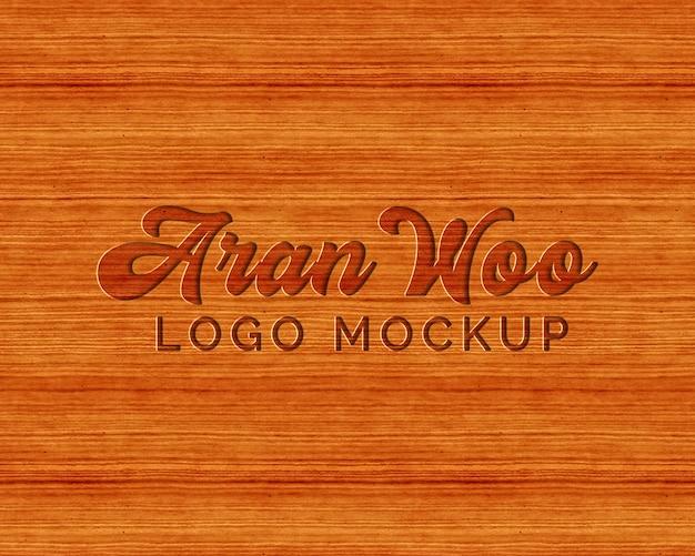Maquete de logotipo pressionado madeira