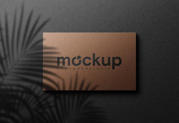 Maquete de logotipo simples e realista em papel prensado