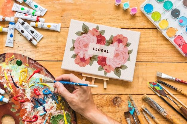 Maquete de lona com materiais de pintura