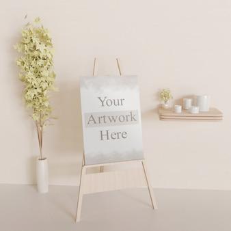 Maquete de lona ou quadro branco sobre o cavalete de madeira